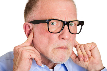 I'm not listening. Angry, insulted old man closes his ears