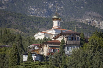 Orthodox church in the village among Crimean mountains.
