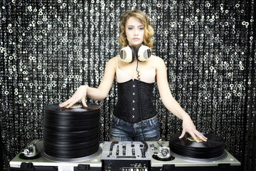 beautiful female dj with pile of vinyl
