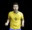 Brazilian soccer player celebrates on black background
