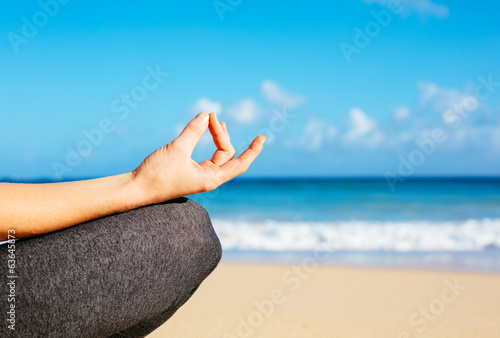 Young woman practicing morning meditation yoga