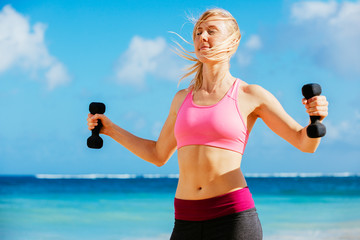 Fitness woman with barbells working out