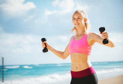 Beautiful athletic young woman exercising