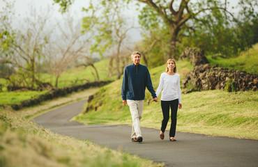 Happy loving middle aged couple walking