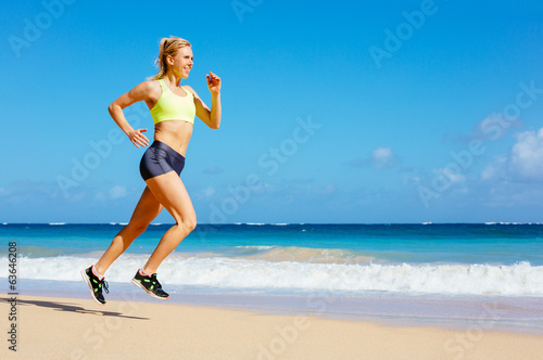 Athletic Woman Running on the Beach