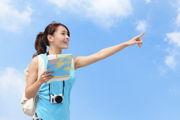 Happy women traveler pointing