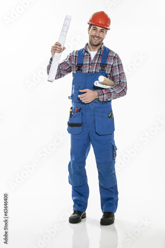 a craftsman in workwear clothing with an hardhat and blueprints