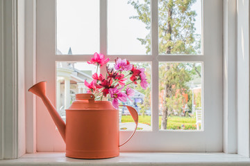 Pot with a flower on the windowsill country house