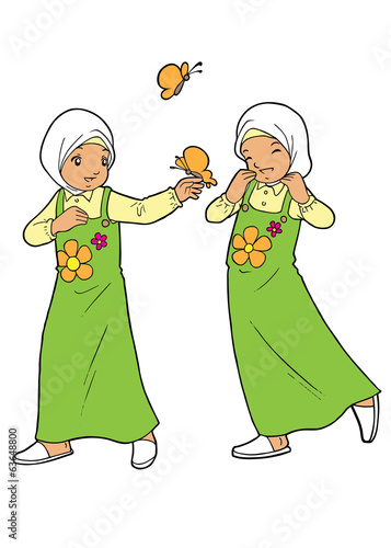 Muslim twin girls playing with butterfly