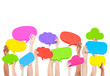 Hands holding multi colored speech bubbles