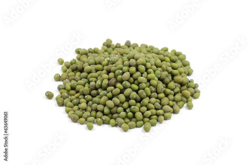 a handful of green millet seeds on a white background