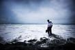 Businessman At Stormy Ocean
