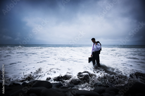 Businessman At Stormy Ocean
