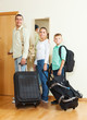 family of three with luggage  going on holiday