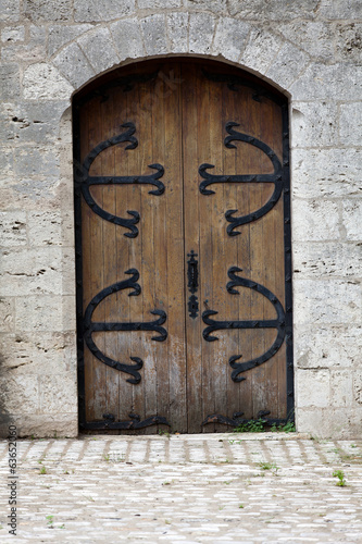 Beautiful old wooden door with iron ornaments