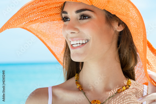 canvas print picture Happy Woman With Orange Hat At Beach