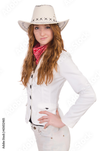 Young  smiling cowgirl isolated on white