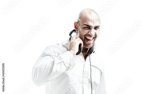 young man with headphones smiling to the camera