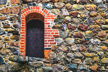 Steel door in stone wall