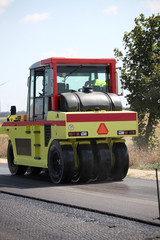 roller compactor at asphalt pavement works for road repairing