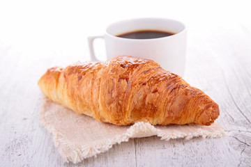 croissant and coffee cup