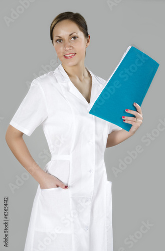 young woman nurse with folder