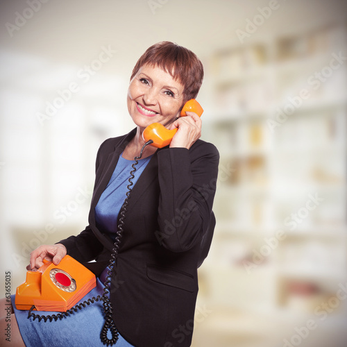 attractive woman  with vintage telephone