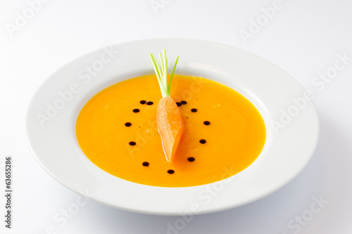Carrot soup with raw carrot and oil drops