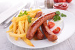 grilled sausage and french fries