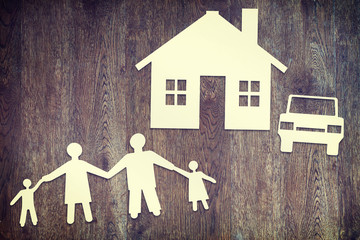 Happy family. Paper scraps on wooden surface