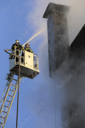 Moscow. Leninsky Prospekt 28. Firefighters work at height.