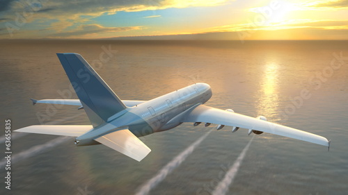 Airplane flying over the sea at sunset, loop-ready