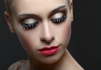 Macro shot of woman's beautiful eye with fashion eyelashes.