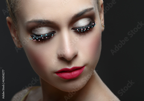 Macro shot of woman's beautiful eye with fashion eyelashes.