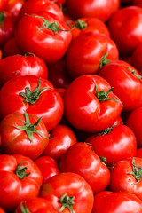 Group of fresh tomatoes background. Ripe red tomatoes on a marke
