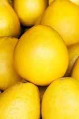 Pomelo fruit background. Pomelo fruit on a market closeup. Citru
