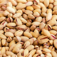 Pistachios background close up. Pistachio Nuts Pile on a market.