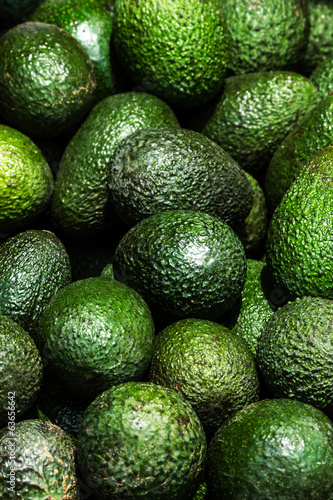 Avocado background. Fresh green avocado on a market stail. Food