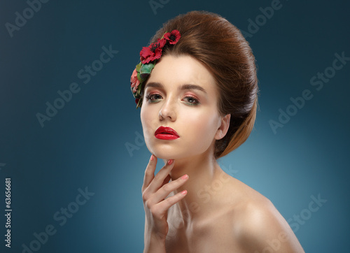 Beauty Portrait. Woman Touching her Face. Beautiful girl with co