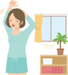 朝の室内で伸びをする若い女性