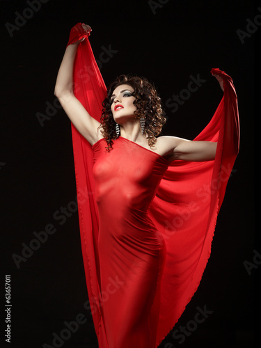 Woman in red blowing flying red dress