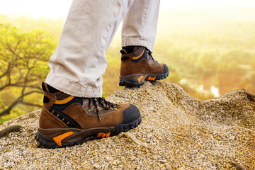 Extreme trekking boots on rocks.