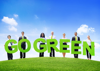 Business People Outdoors Holding Texts Go Green
