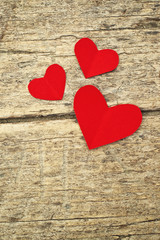 Paper hearts on wood background
