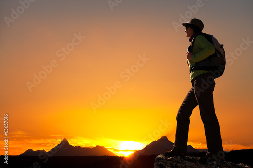 Silhouette of female hiker at sunset.