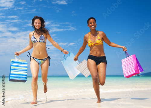 canvas print picture Women with shopping bags on a tropical beach