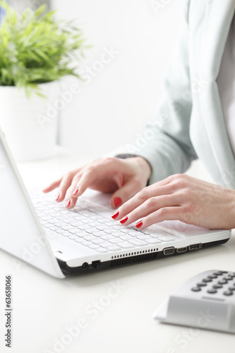 Businesswoman working on laptop.