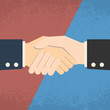 Handshake on red blue background