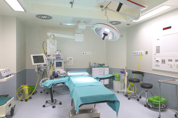 Surgery room interior with medical equipment.