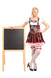 Woman in costume standing by a blackboard